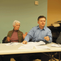 Richard Caccappolo, chairperson of Community Board 2's Parks and Waterfront Committee, responding to comments from the audience about the Washington Square Park Conservancy at the March 5 meeting. Beside him, from left, were committee members Judy Paul, Frederica Sigel and Shirley Secunda.