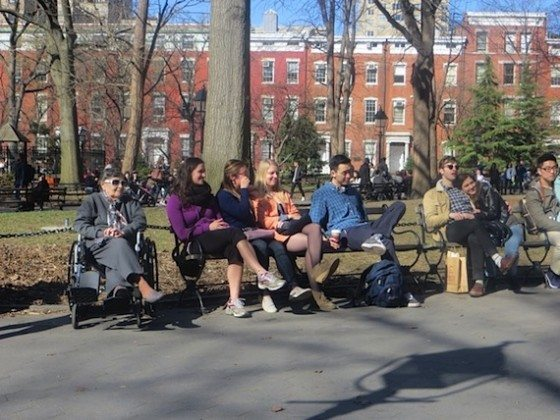 people_watching_colin_huggins_piano_player_washington_square_park