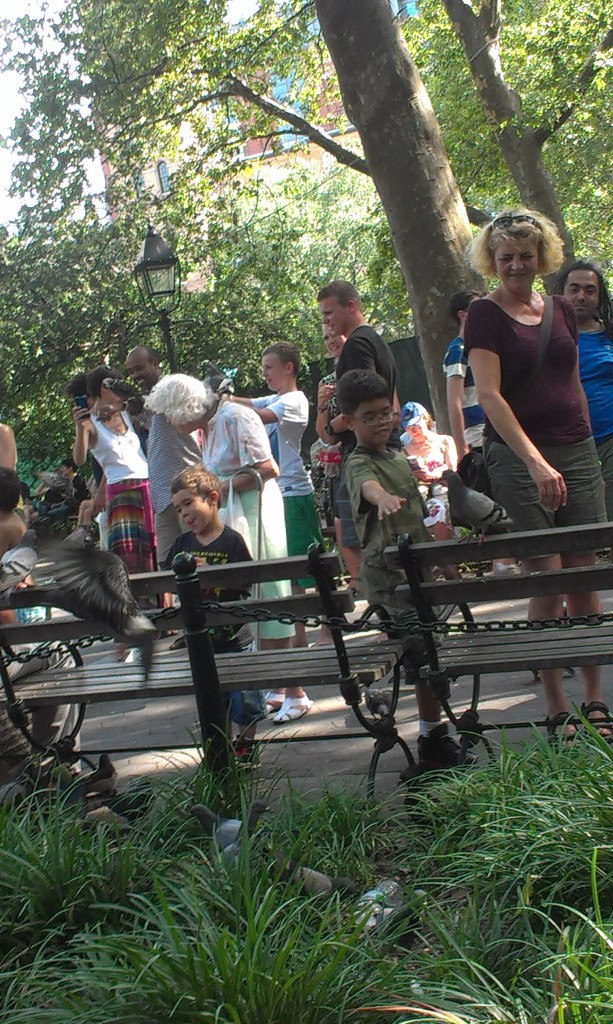 people-with-pigeons-washington-square-park