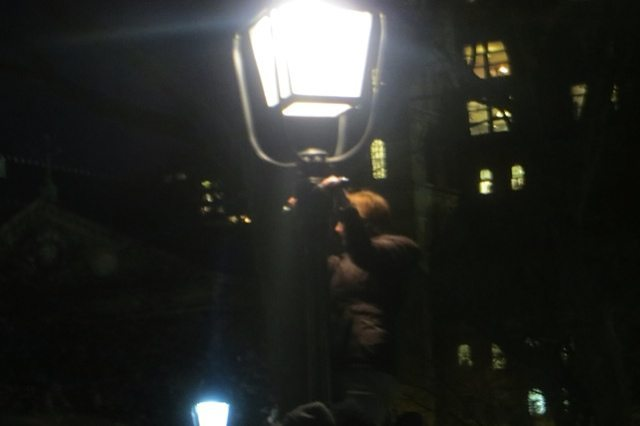 Gal Climbs Light to See Sanders