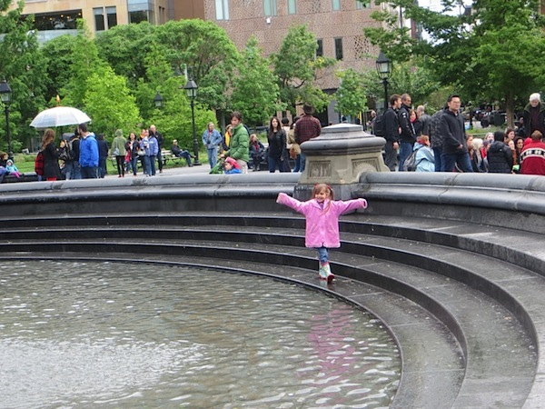 girl_in_pink_raincoat_in_the_fountain_washington_square_park_greenwich_village_1