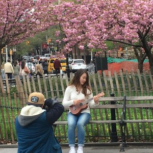 gal-with-ukelele-blossoms-washington-square-park-spring