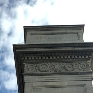 What is the Significance of the Roman Numerals on the Washington Square Arch?